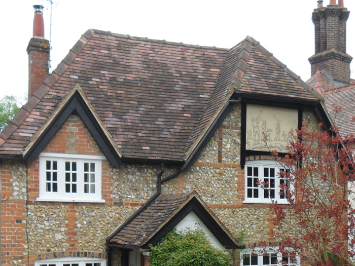 Traditional brick and flint cottage, re-roofed using original tiles