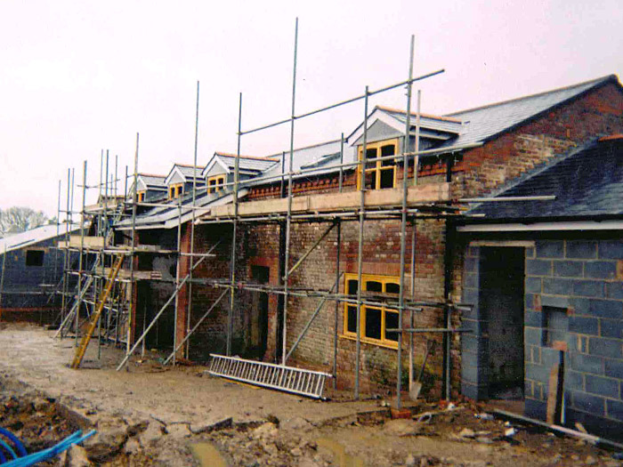 Former farm building conversion with new slates