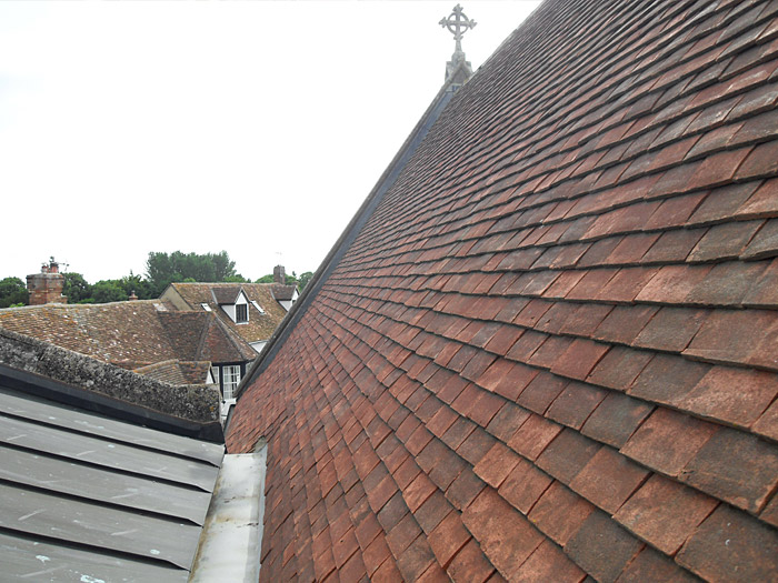 Haddenham church, old tiles removed, recovered using new handmade clay tiles