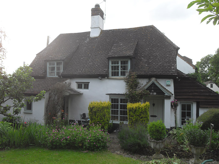 Before: traditional Bucks cottage re-roofed in the 70's with concrete tiles